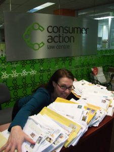Consumer Action's office manager with all our sticker requests
